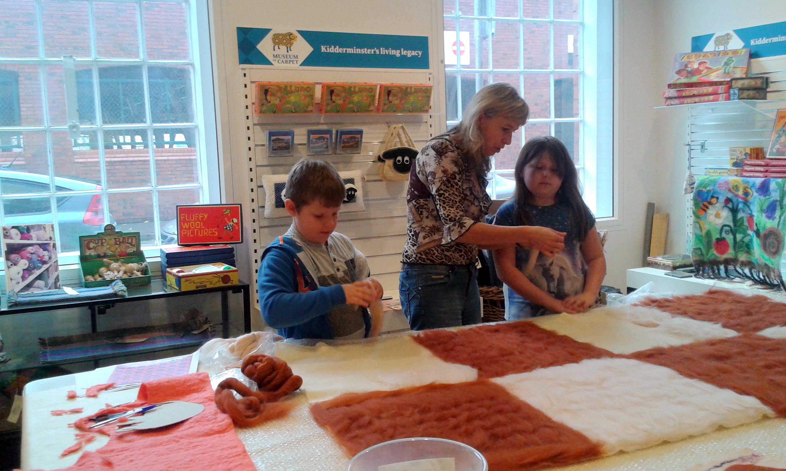 Raya working with children at carpet museum