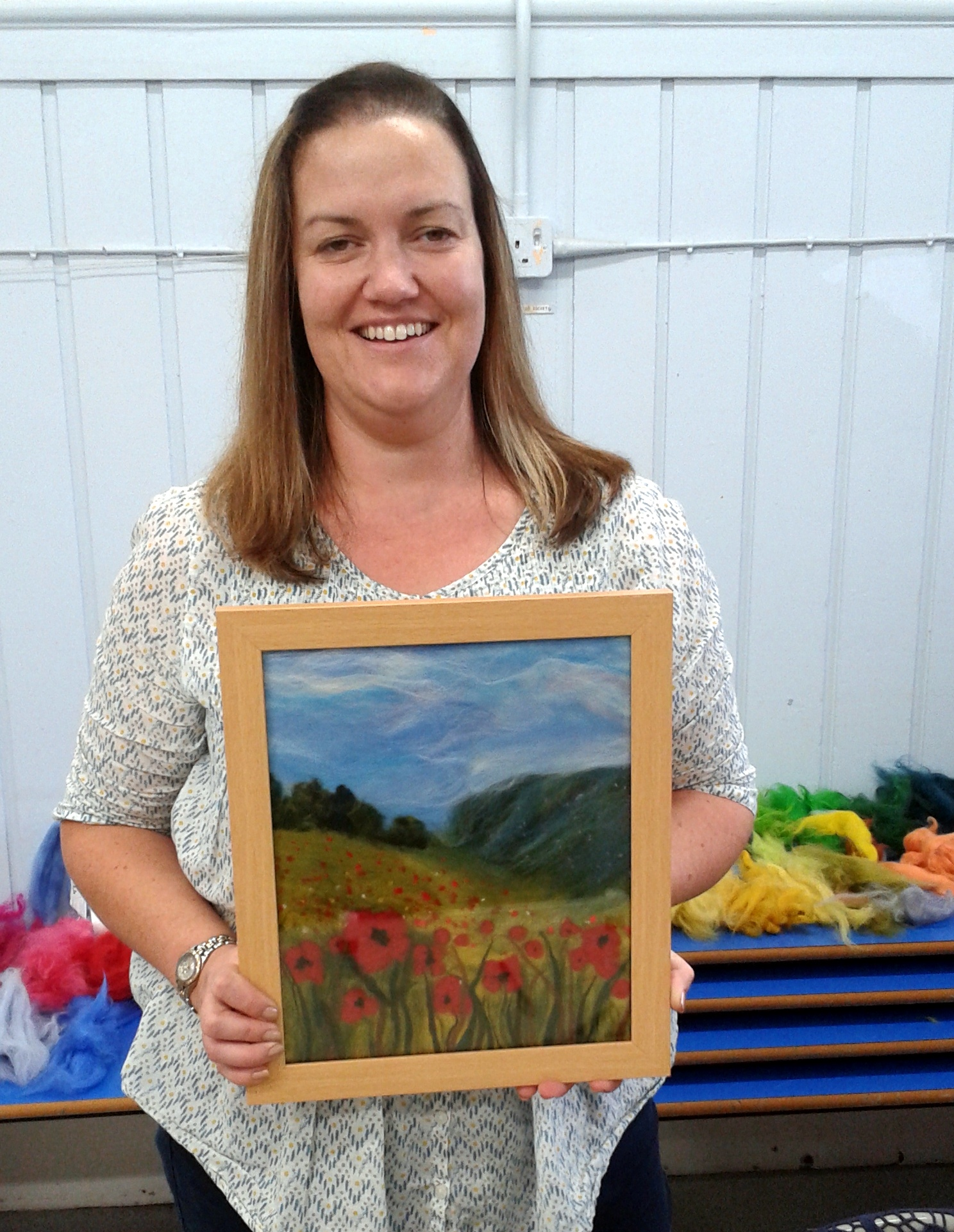 Sally with her 'Poppy Fields' wool painting