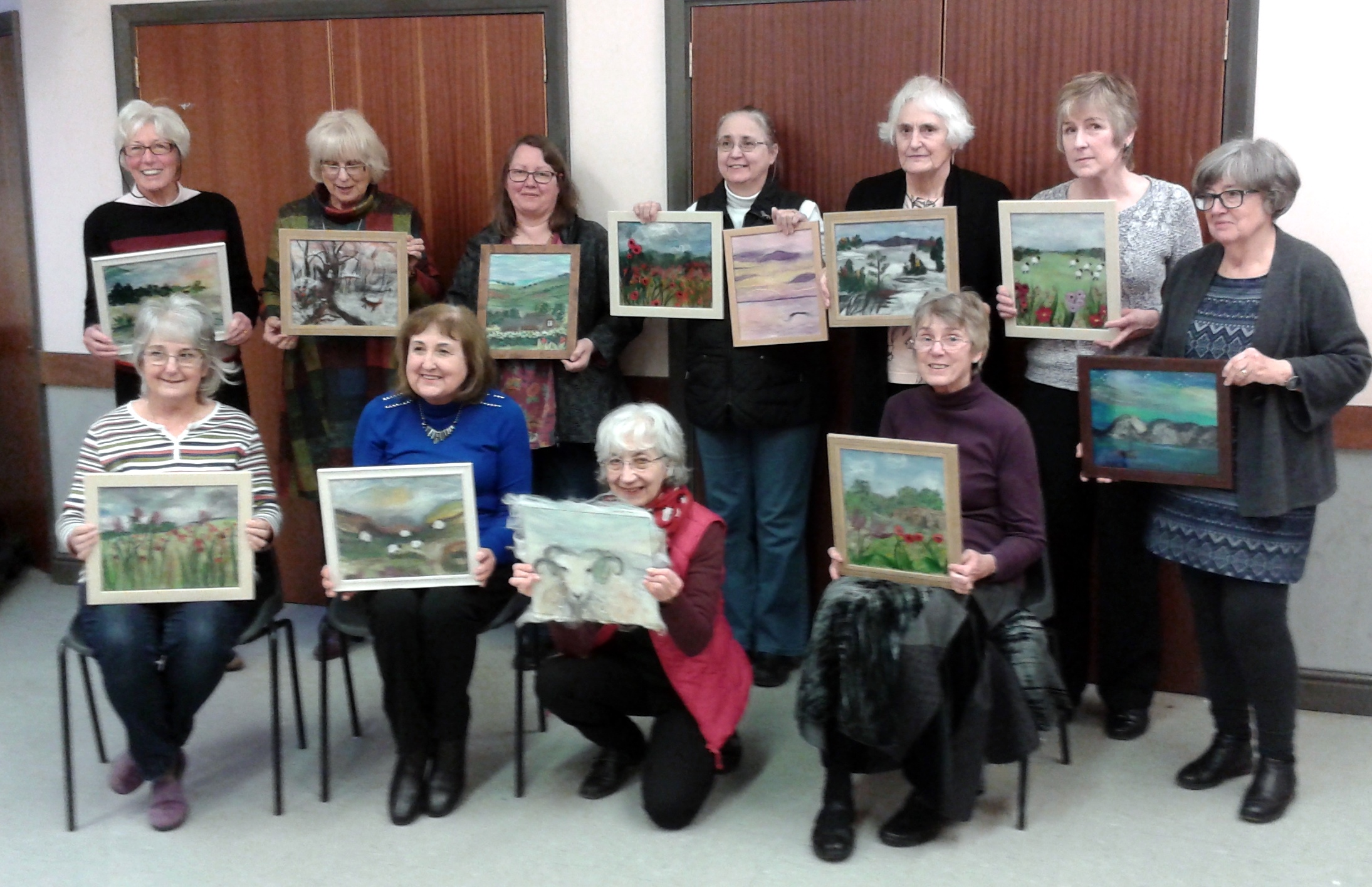 Creative stitchers group with their beautiful wool paintings
