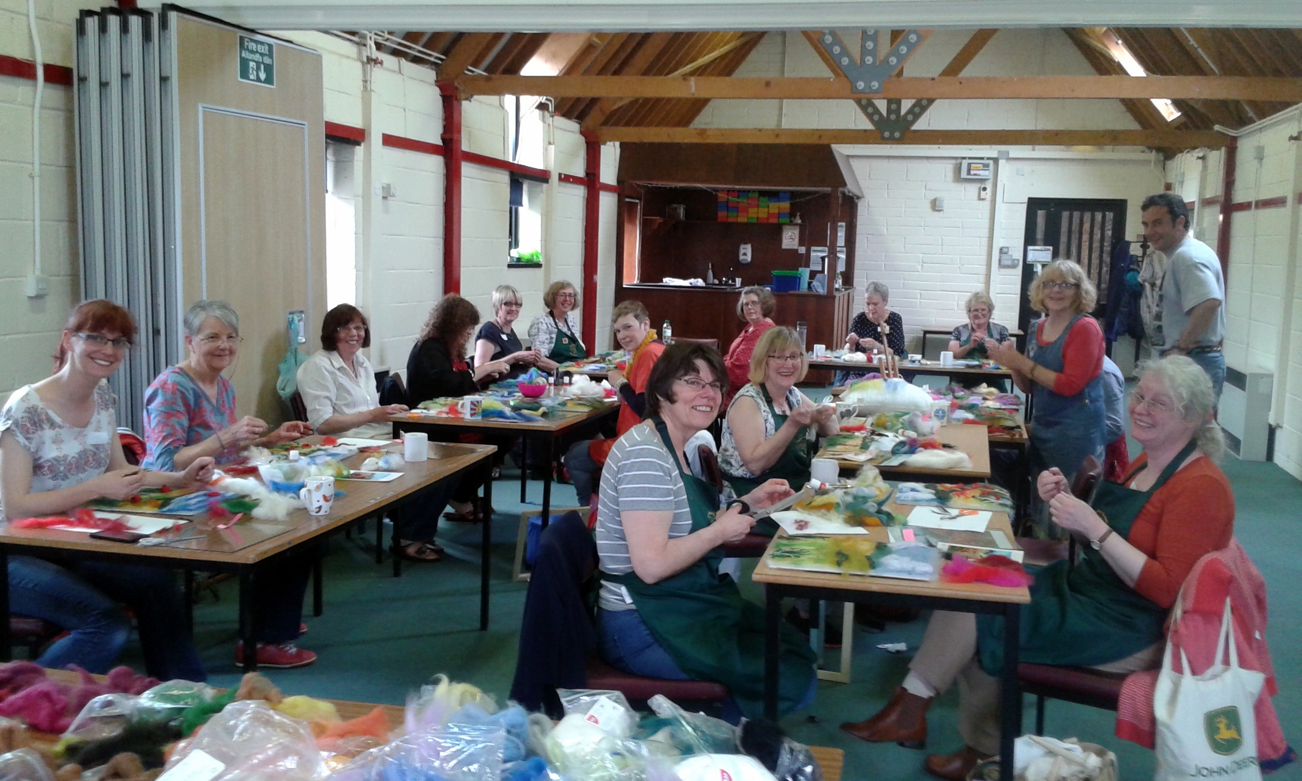 Students from Gwen Guild of Weavers, Spinners and Dyers are making wool paintings