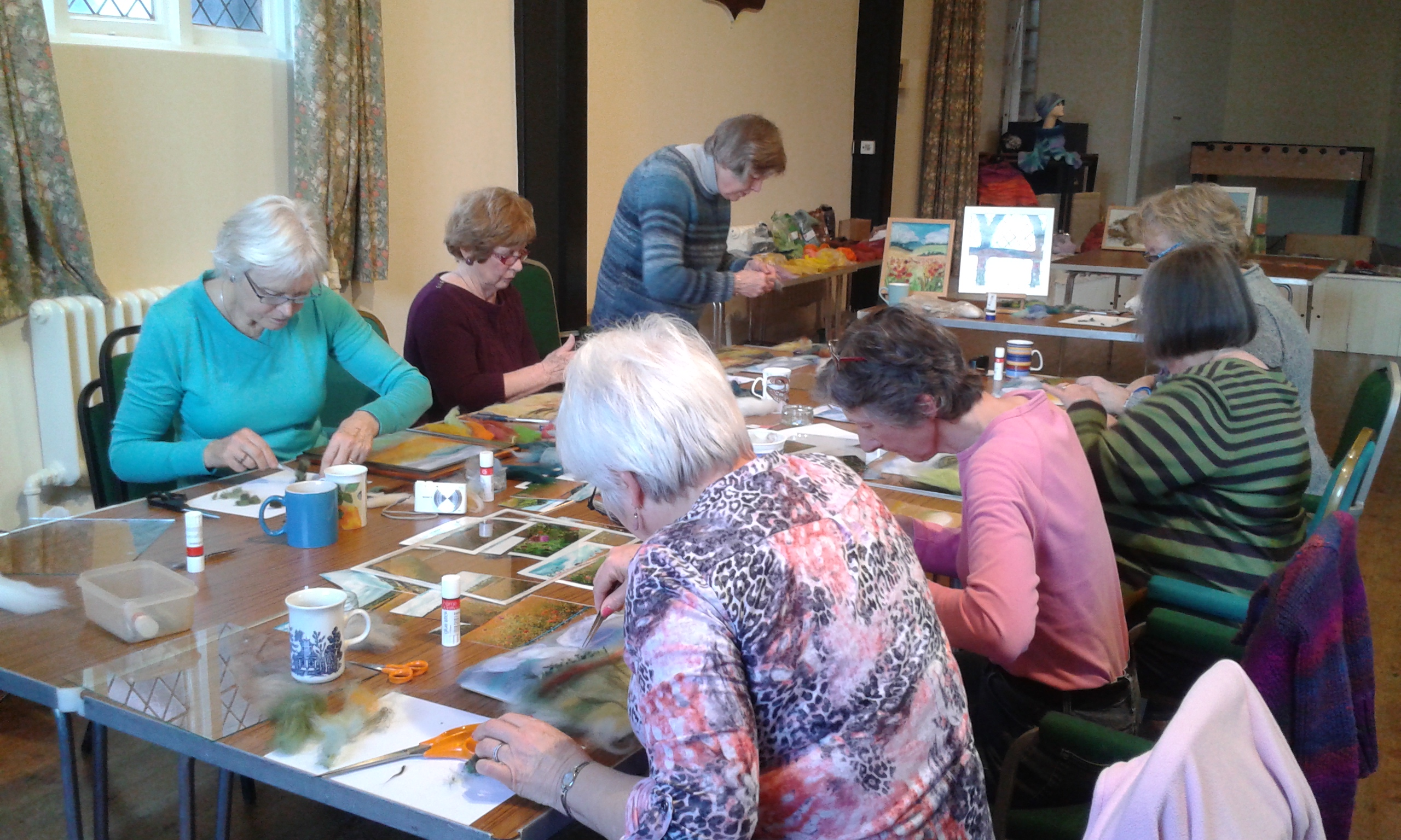 Ladies creating their lovely wool paintings