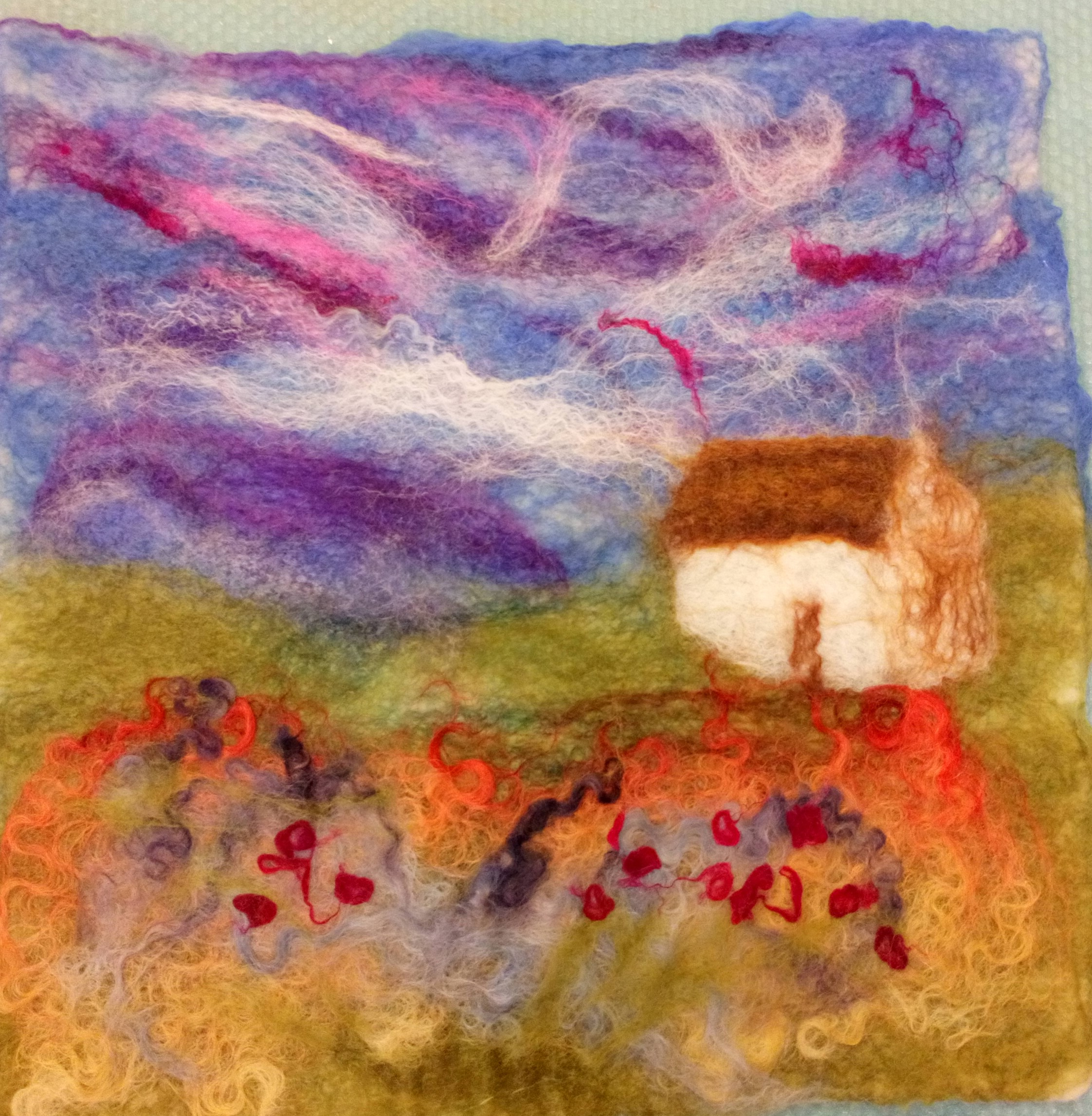 Felted wall handing of a landscape made by a student at Raya's wet felting class for the beginners in Cotswold.