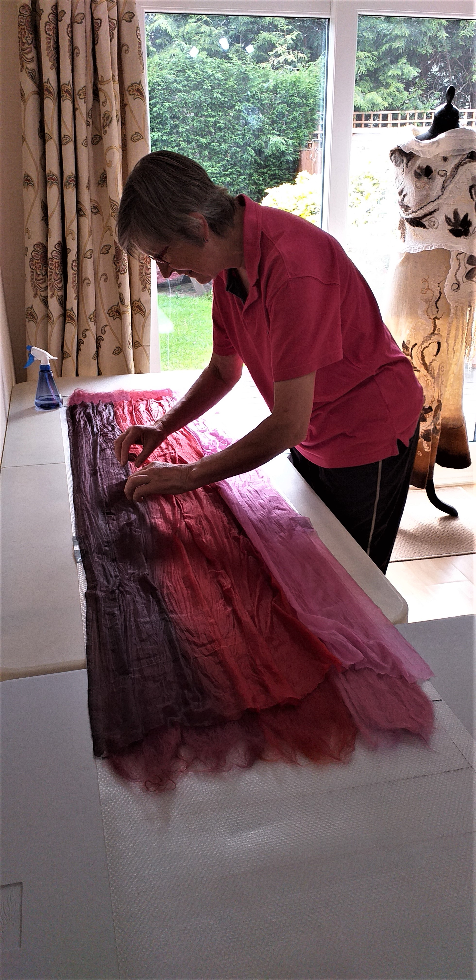 Laying silk fibres for a Nuno felt project at Magic Wool Art and Craft Studio in West Midlands