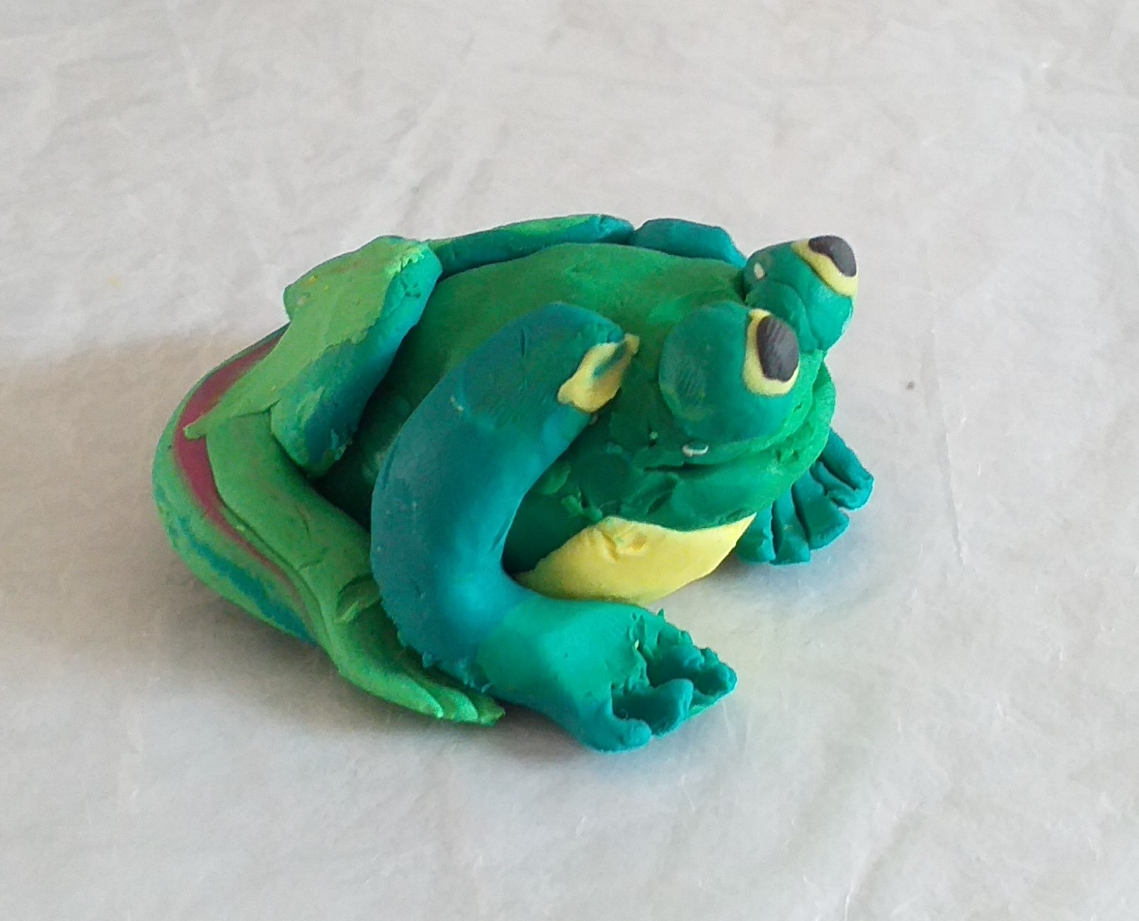 The old toad from a story of Thumbelina made by a child at Art club for children at Magic Wool Art and Craft Studio