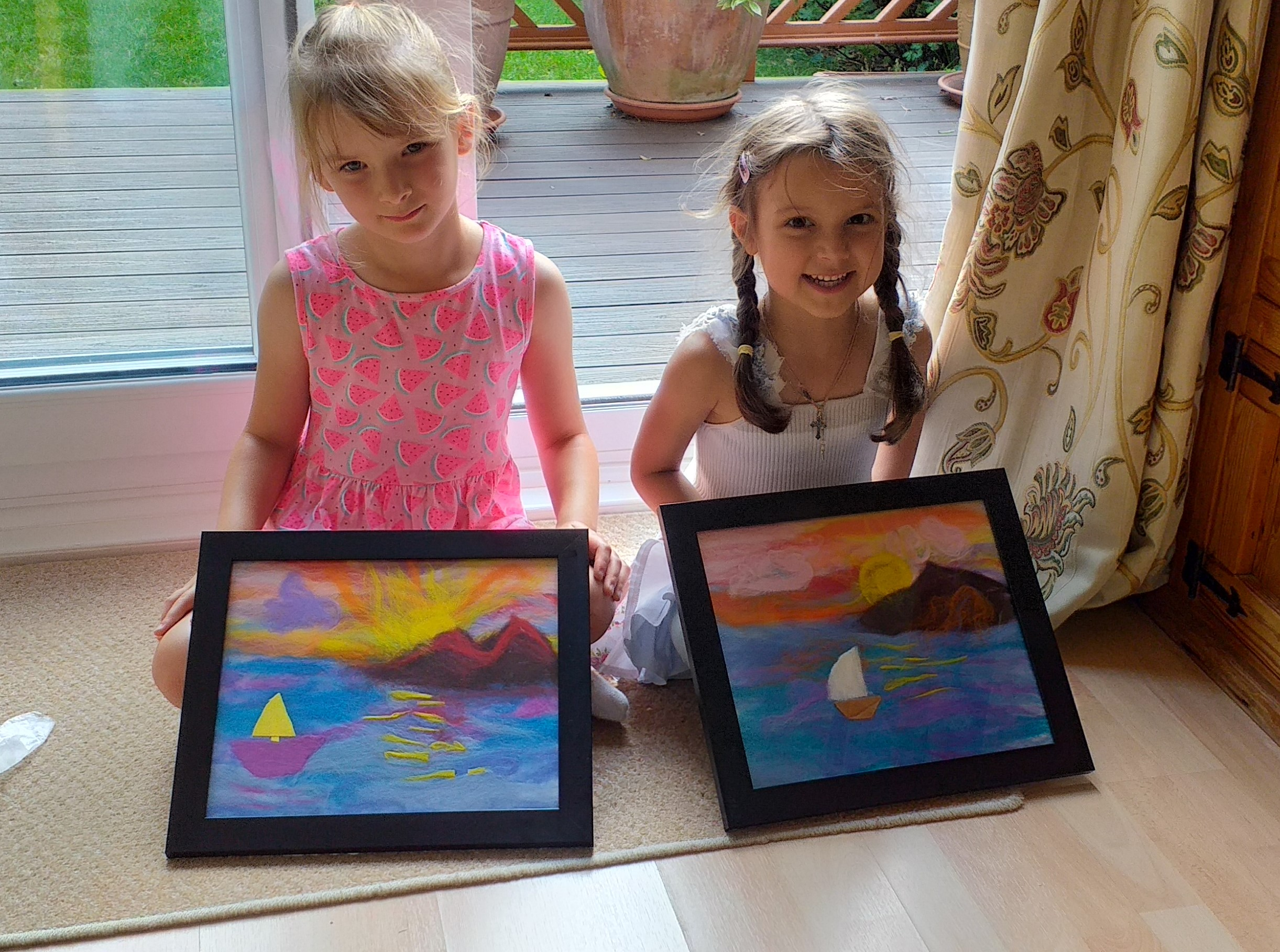Little artists with their finished wool paintings at Magic Wool Art and Craft Studio in Kidderminster