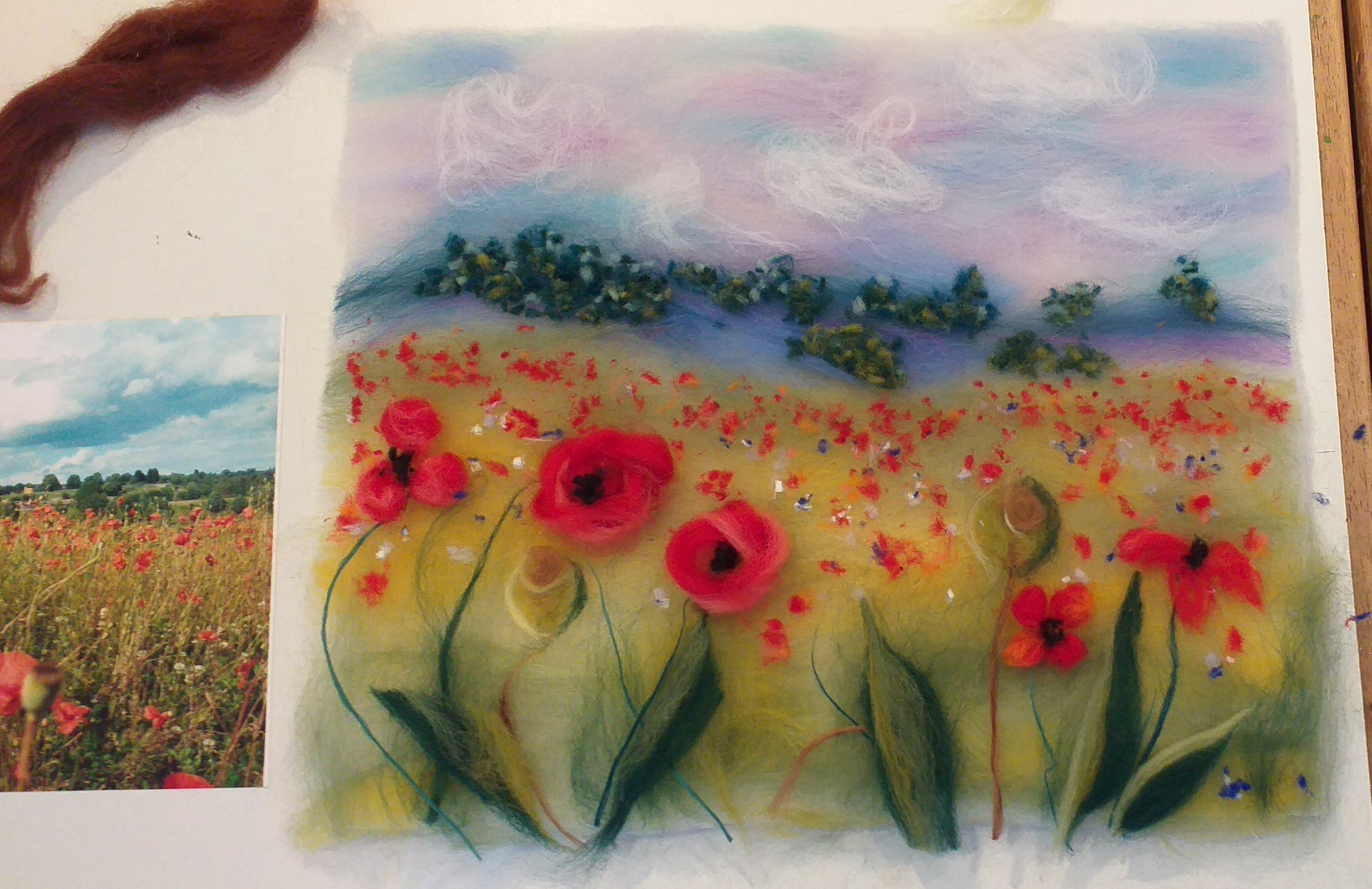 Poppy fields wool painting is being created by Chrys Hendi-Warner at Bevere Art Gallery