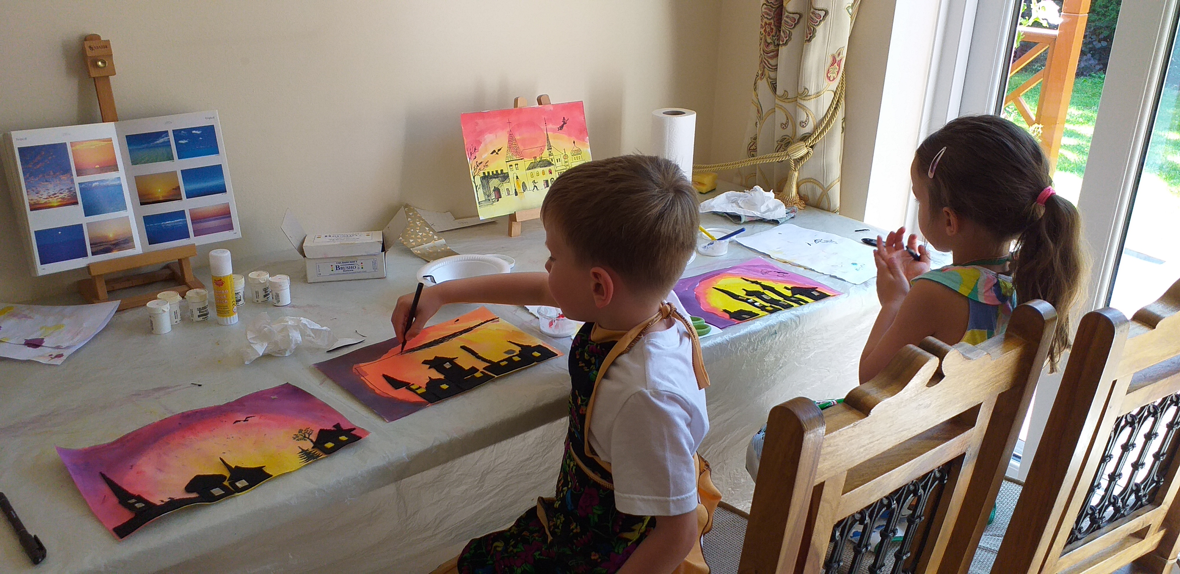 Children painting and drawing at Magic Wool Art and Craft Studio at Kidderminster Worcestershire