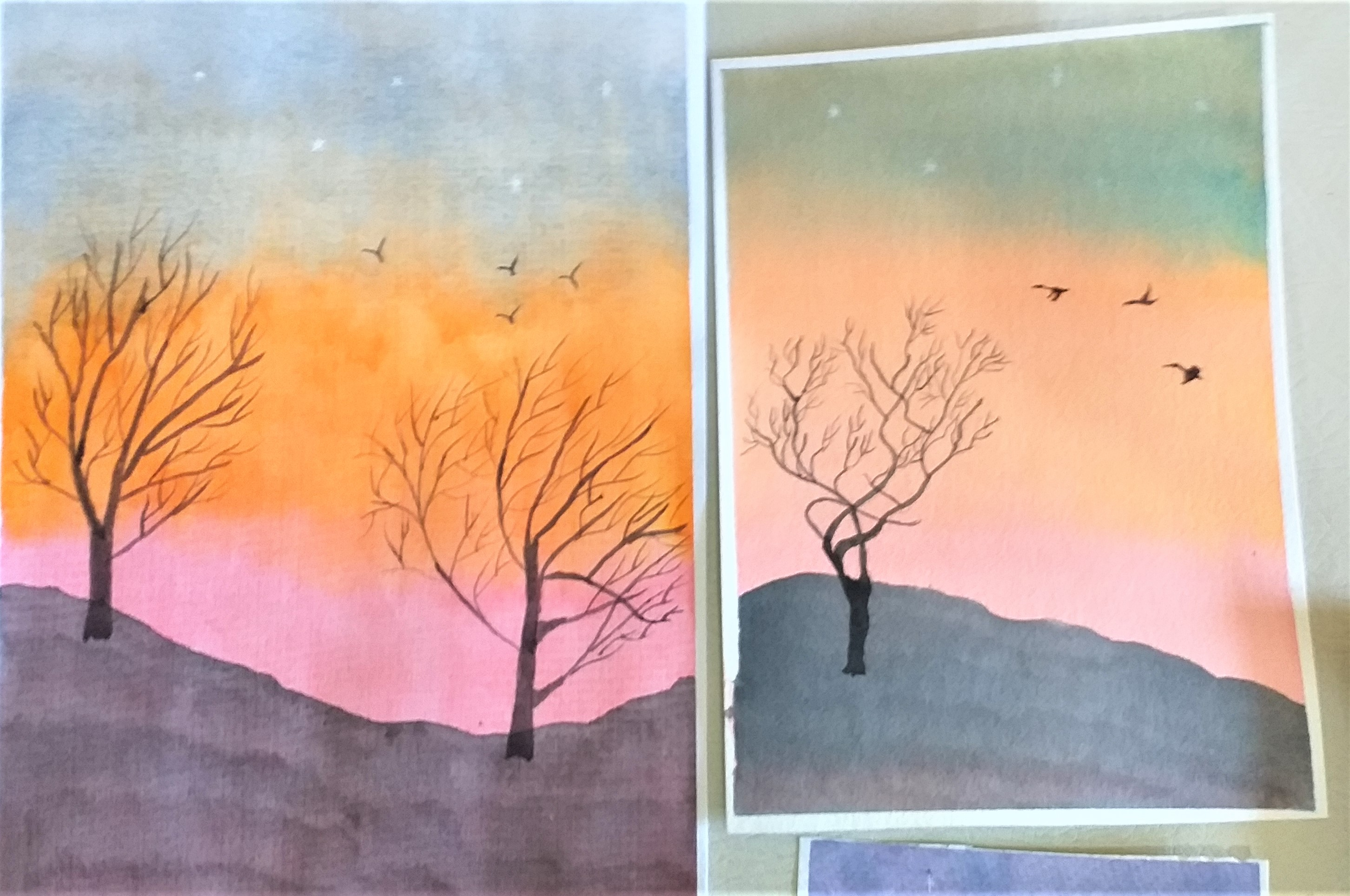 Beautiful watercolours of sunset produced at Art course in Worcestershire