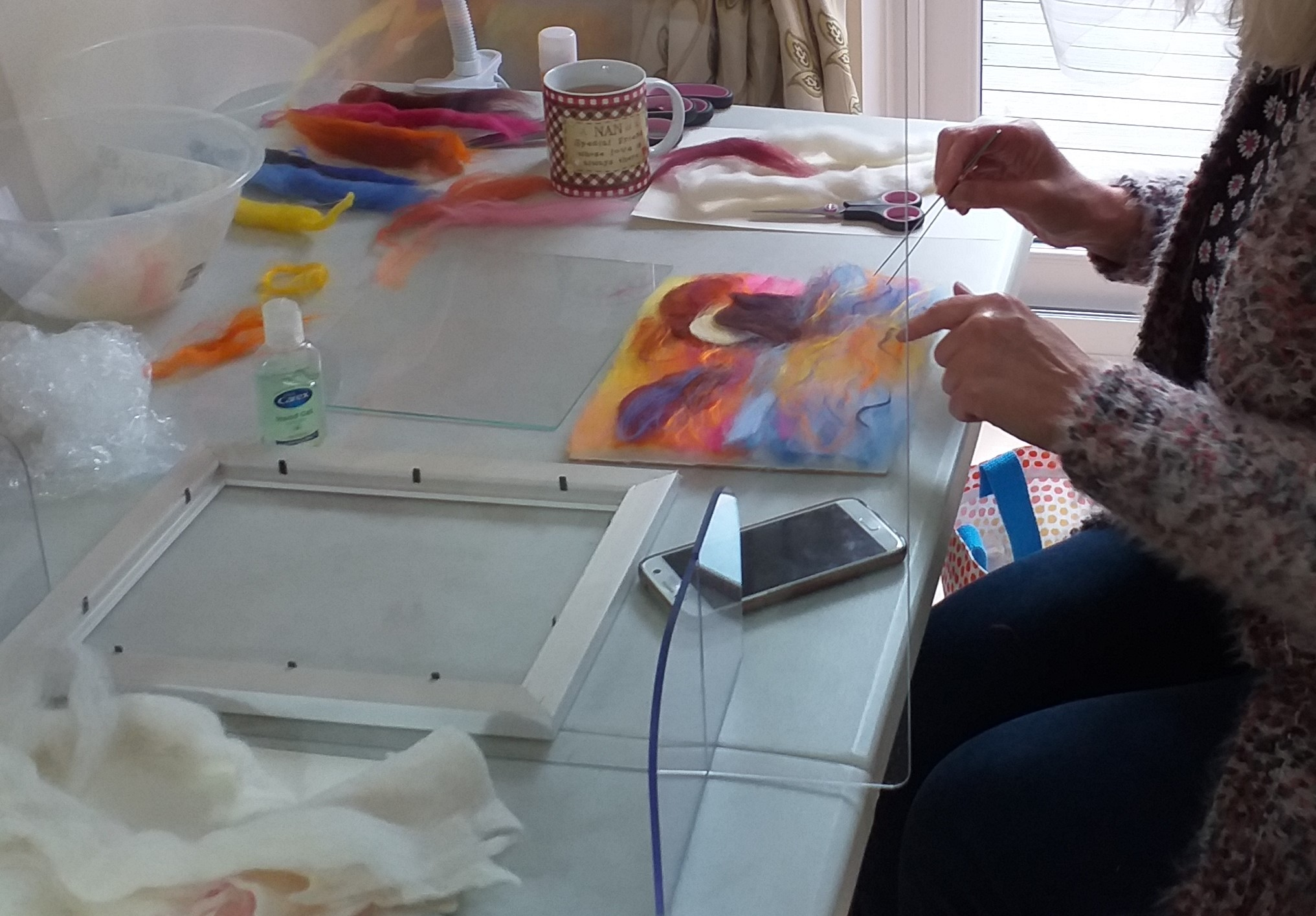 Louise working on her wool painting