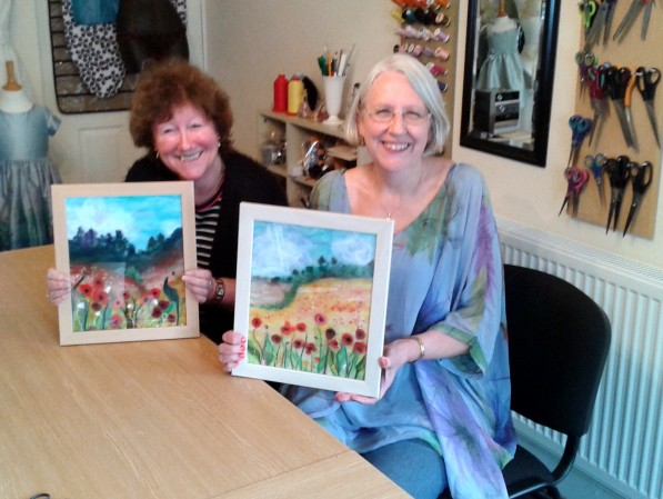 Sue and Stephanie with their wool paintings
