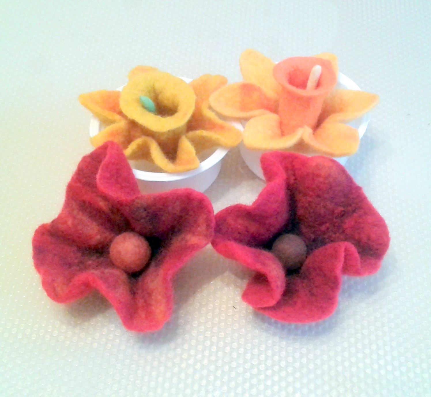 Handmade felted poppies and daffodils created by Jenny and Margaret with Textile Artist Raya Brown