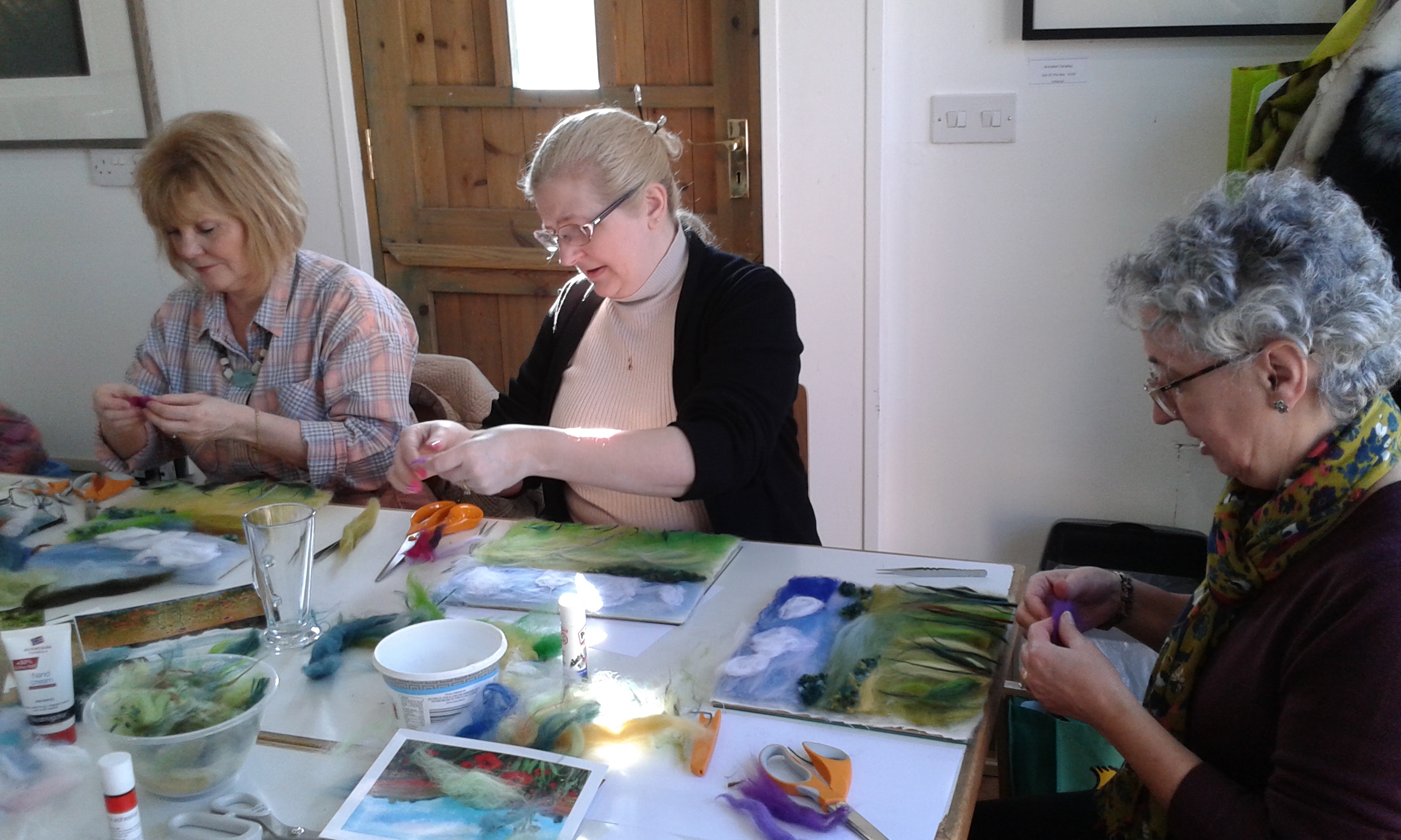 Students creating wool paintings with Textiles Artist from Worcestershire Raya Brown