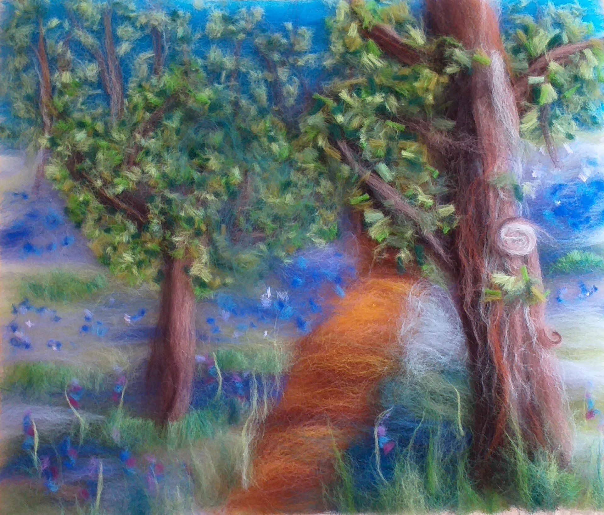 Clare's wool fibre painting with Bluebell woods made with merino wool fibres at Bevere Art gallery