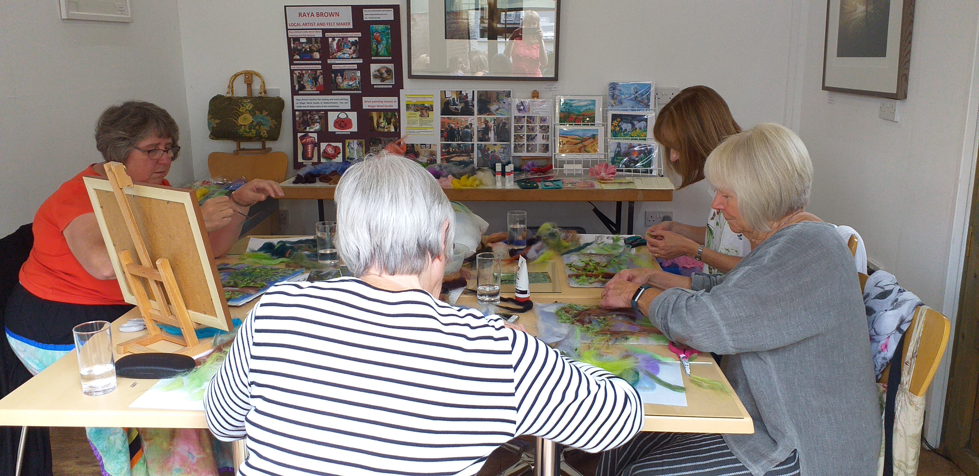 adult learners creating wool fibre paintings at Bevere Art Gallery in Worcestershire