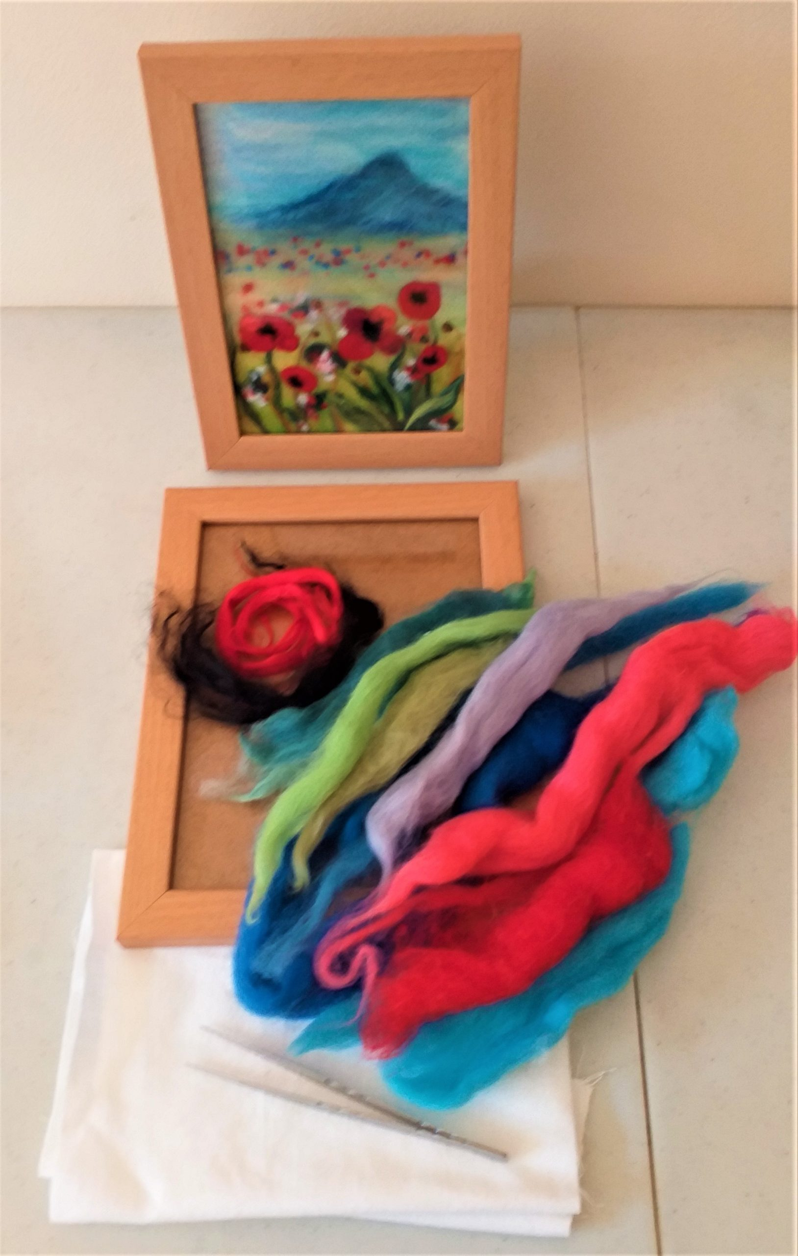 Field with red poppies wool painting kit is used at our online wool painting courses