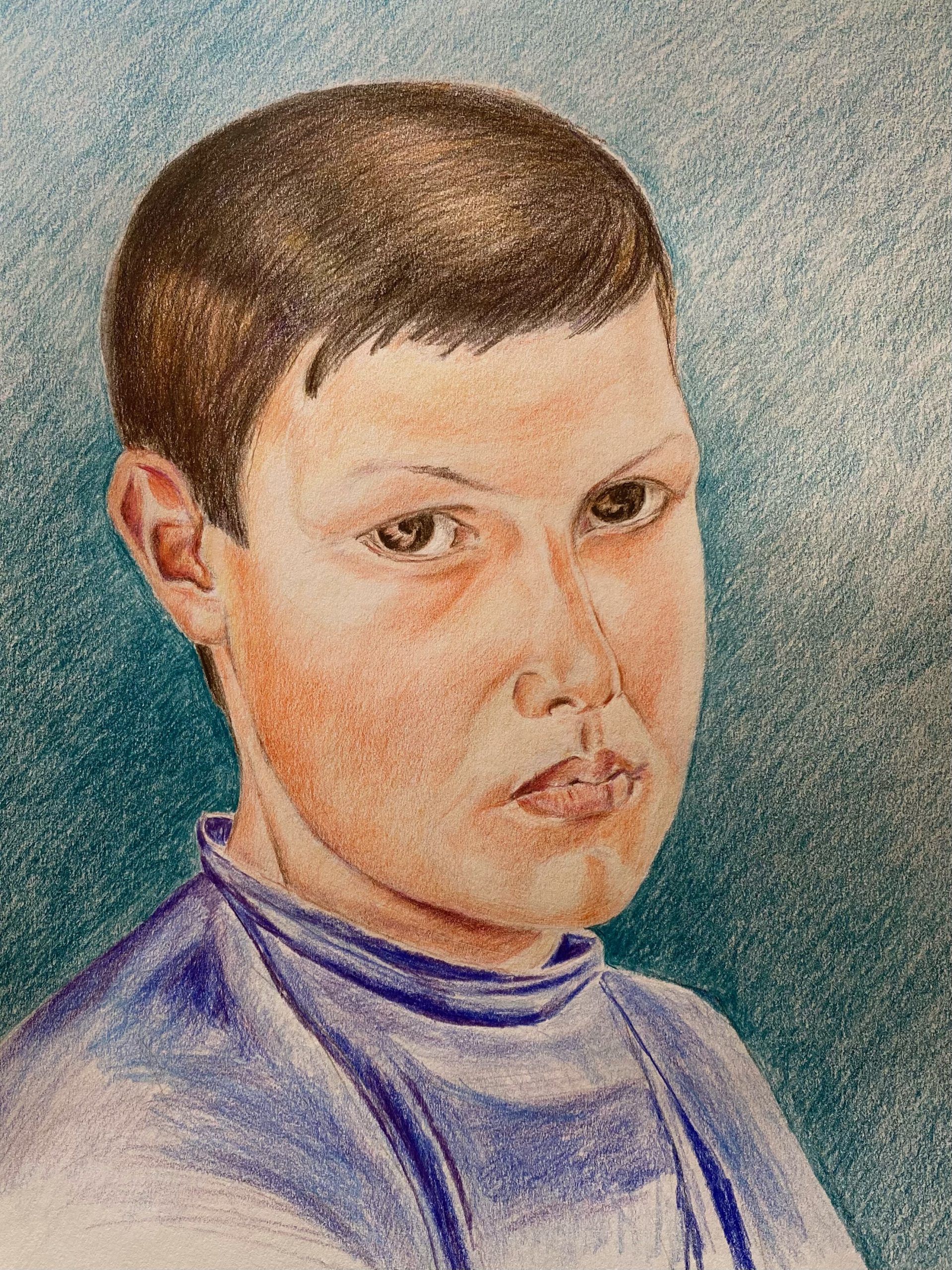 Coloured pencil drawing of a boy created at online Art Portrait course by Emily